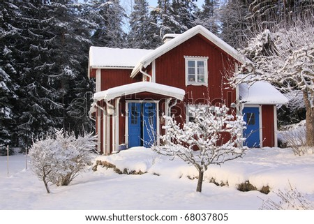 Swedish red cottage in winter.