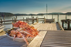 Swedish-style, simple, natural shellfish platter served on a peaceful wooden pier with the tranquil archipelago all around. Fine dining al fresco at its best on a flat calm, balmy summer's evening.