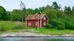 Swedish typical style house cottage in the green