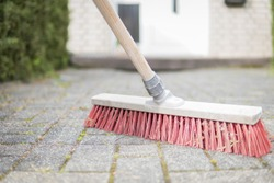 sweep the way with a red broom