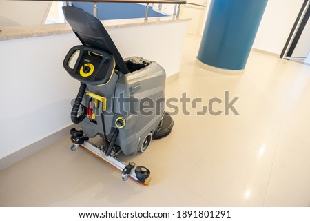 Sweeping machine for a building or compound entrance Stock foto ©