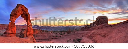 Sweeping sunset panoramic view of famous Delicate Arch in Arches National Park in Moab, Utah (HDR)