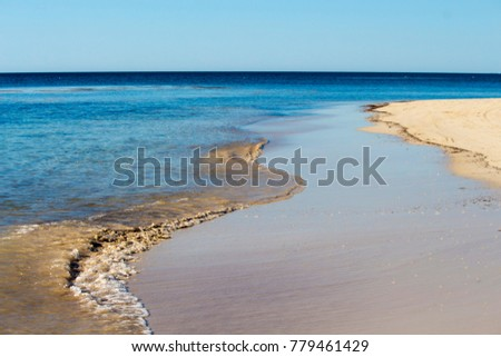 Sweeping view of the soft white sandy beach  and  Indian Ocean waves at Hutt's Beach near Bunbury Western Australia on an  early summer afternoon is cool and inviting. #779461429