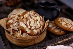 Sweet almond cookies  on wooden table.French homemade cookie. Useful Lenten cookies from almond flour with honey on rustic wooden background. Selective soft focus.