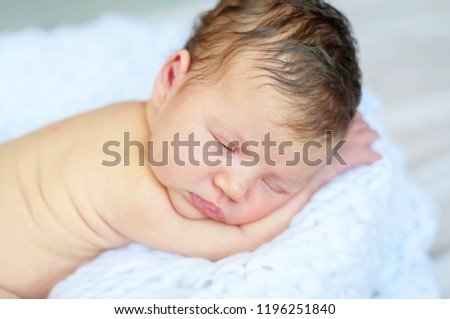 Sweet and innocent infant baby sleeping on a soft white blanket. Newborn photo session. #1196251840