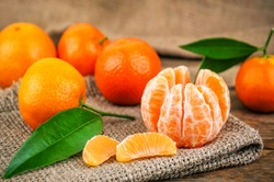 sweet and ripe mandarines (tangerines) with leaves