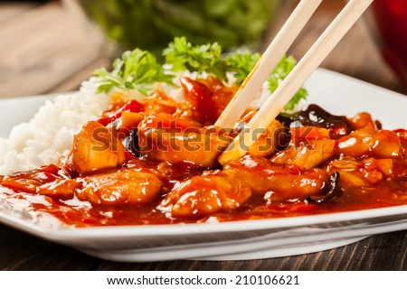 Sweet and sour chicken with rice on a plate ストックフォト ©