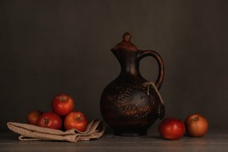 sweet apples with a jug on a wooden table. foodphotography