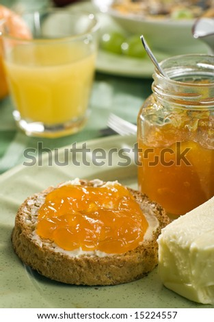 sweet apricot jam on toast close up