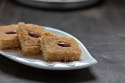 sweet arabic middle eastern food on a black background. - Image