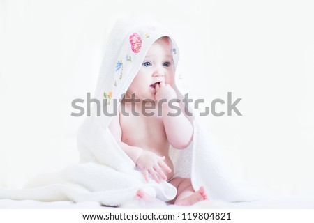 Sweet baby girl in a cross-stitched handmade towel
