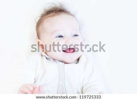Sweet baby girl laughing and playing - stock photo