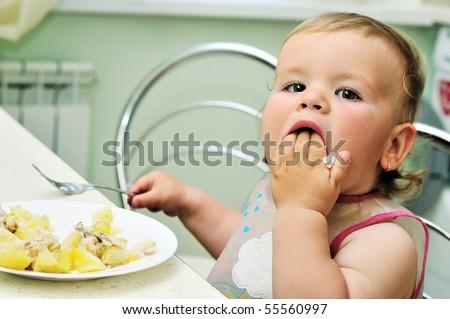 sweet baby girl  like eating on her own
