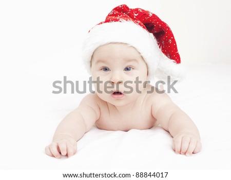 sweet baby in Santa's hat