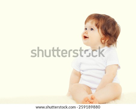 Sweet baby sitting and looking away, copy space