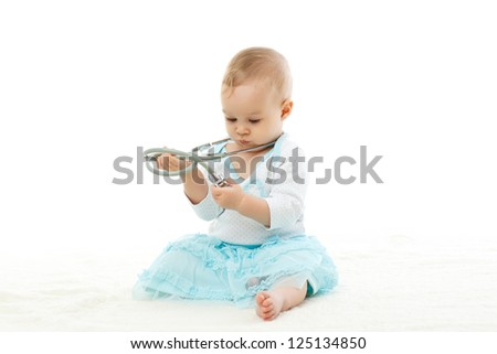 Sweet baby with stethoscope on a white background