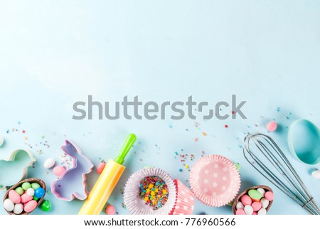 Sweet baking concept for Easter,  cooking background with baking - with a rolling pin, whisk for whipping, cookie cutters, sugar sprinkling, flour. Light blue background, top view copy space #776960566