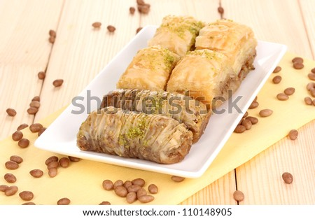 Sweet baklava on plate on wooden background