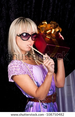 Sweet blond girl with a present