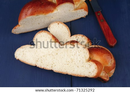 sweet bread : french bread cuts over blue wooden table