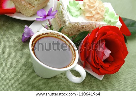 sweet breakfast : whipped cream cake with roses and hot black coffee #110641964