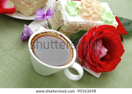 sweet breakfast : whipped cream cake with roses and hot black coffee #90563698