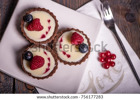 Stock Photo Sweet cake selection, desert with chocolate, fruit and fresh flowers