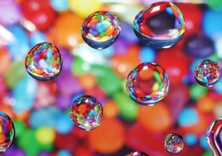 Sweet candy background with water drops reflecting and magnifying the sweets