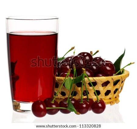 Sweet cherries in a basket and glass of juice on a white background