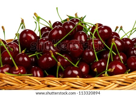 Sweet cherries in a basket isolated on a white background