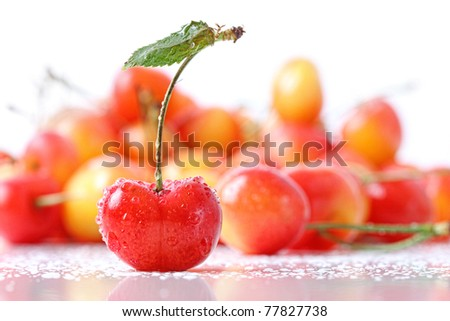 Sweet cherries with droplets isolated on white background - stock photo
