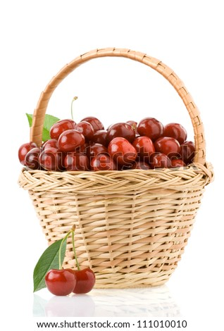 sweet cherry in basket isolated on white background