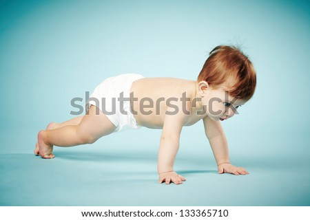 sweet child crawls on blue background