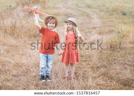 Sweet childhood. Memories of childhood. Valentine day. Kids dreams of becoming a pilot. Human emotions kids first love. The concept of child kindness and childhood #1537816457