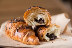 Sweet Chocolate Croissants (selective focus) on vintage wooden background