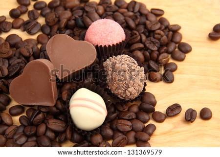 sweet chocolate hearts on dessert menu on dark brown coffee beans on Holiday theme