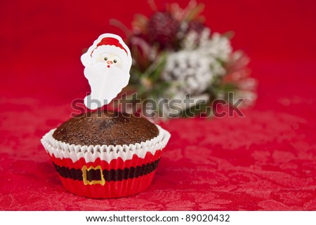 sweet christmas cupcake decorating with icing and sprinkles on a red background