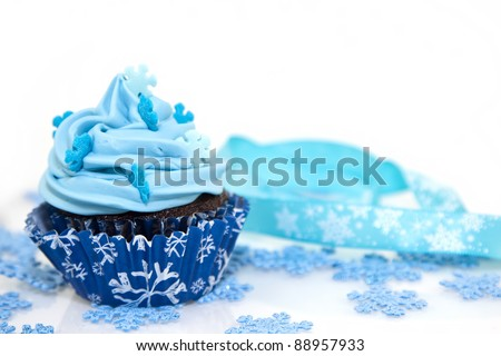 sweet christmas cupcake decorating with icing , sprinkles and candy on a white background