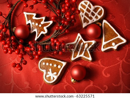 sweet christmas gingerbreads and red christmas ornaments