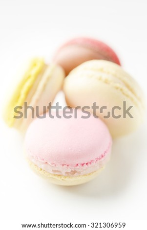Sweet color macarons over white background for copy space.