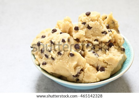 Sweet cookie dough with chocolate chips on a table Stock photo ©