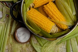 Sweet corn boil with salt. cooked sweet corn in pot on wooden table.