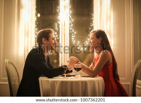 Sweet couple celebrate their anniversary in a romantic restaurant #1007362201