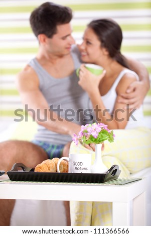 Sweet couple enjoying in morning with breakfast