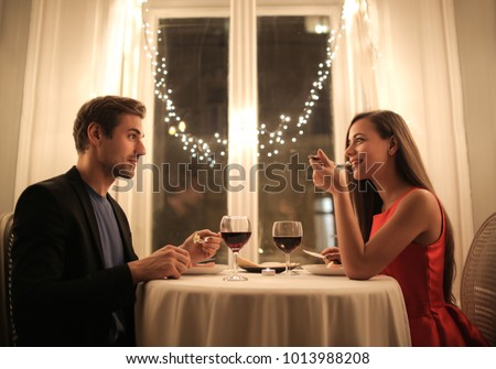 Sweet couple having a romantic dinner #1013988208