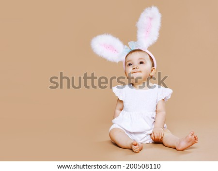 Stock Photo Sweet cute baby in costume easter bunny
