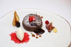 Sweet desert with jelibon, fruit and icecream on white background
