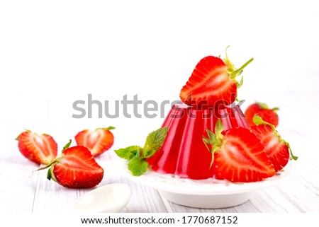 Sweet dessert jelly pudding with strawberries on white plate Stock photo ©