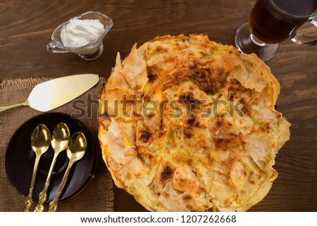 Sweet dessert made of dough and baked Golden brown, spoon and paddle portions, wooden background.
