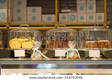 Sweet desserts on shopping window in small cafe #616763048